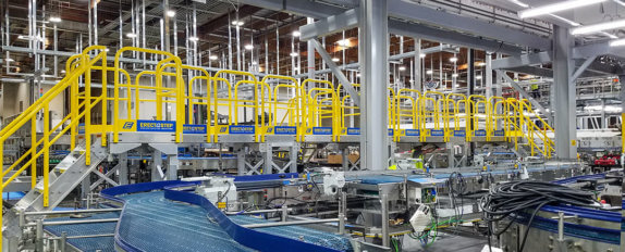 ErectaStep material handling conveyor crossover at the Nestle Waters Facility in Ontario CA.
