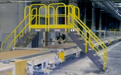 Erectastep certainteed industrial crossover stairs at manufacturing facility