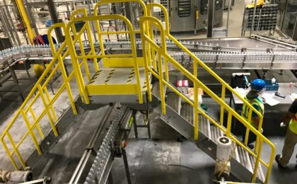 Erectastep industrial crossover stairs at bottling plant