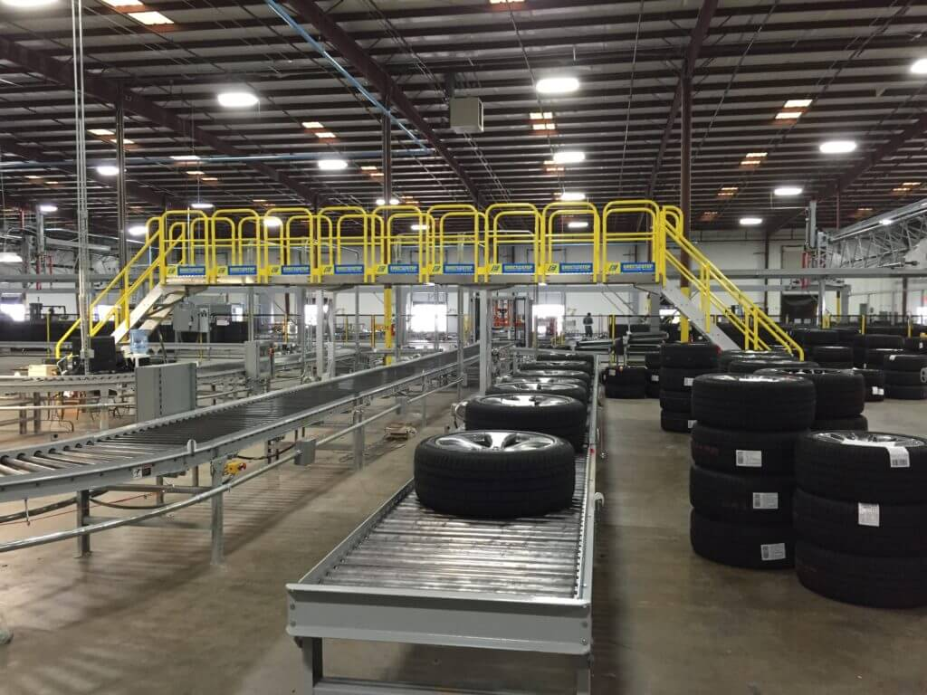 Erectastep crossover stairs in tire distribution center