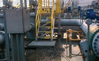Erectastep industrial crossover stairs over outdoor spill channels