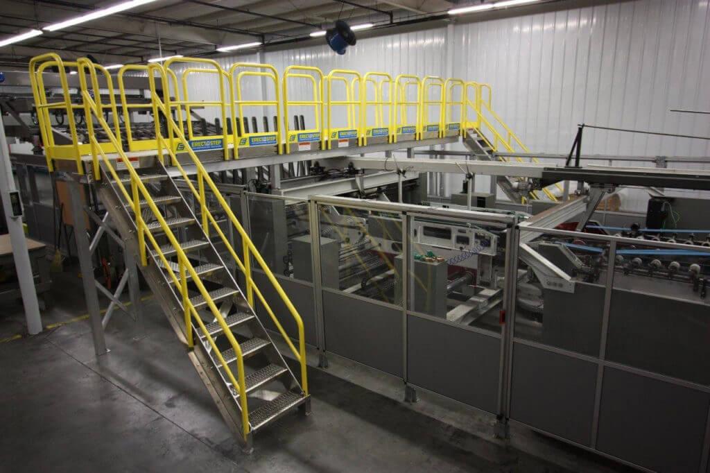 Erectastep industrial stairs with raised walkway service platform