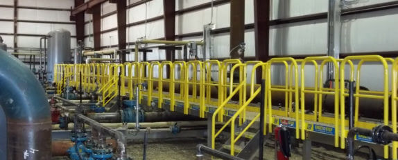 Erectastep crossover stairs and walkway over pipes