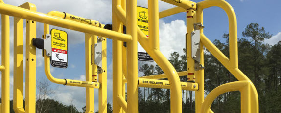 YellowGate safety swing gate mounted to ErectaStep metal stair crossover