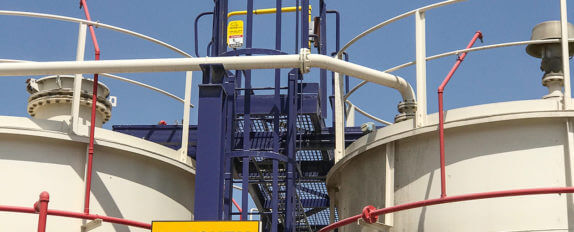 YellowGate mounted atop of safety ladder access for oil industry tank storage unit