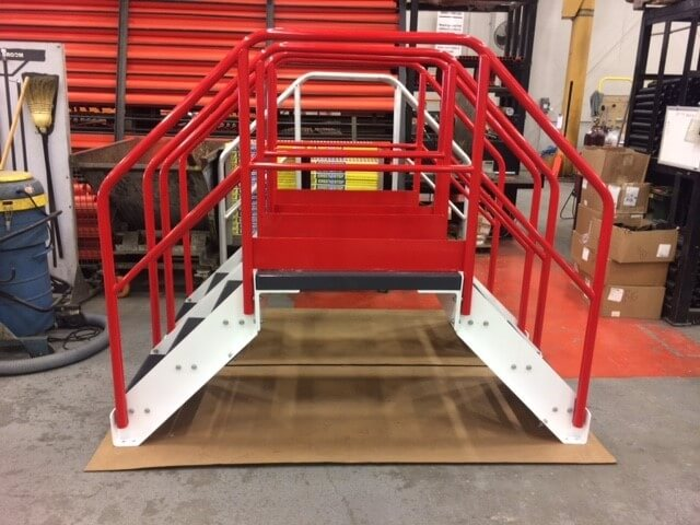 Side View of Red Conveyor Crossover Stairs