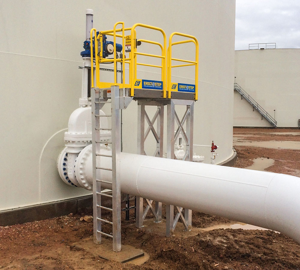 Erectastep crossover industrial stairs next to tanks at Petrochem Colorado