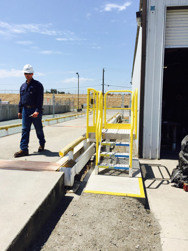 Erectastep industrial crossover stairs to building at NuStar for workers