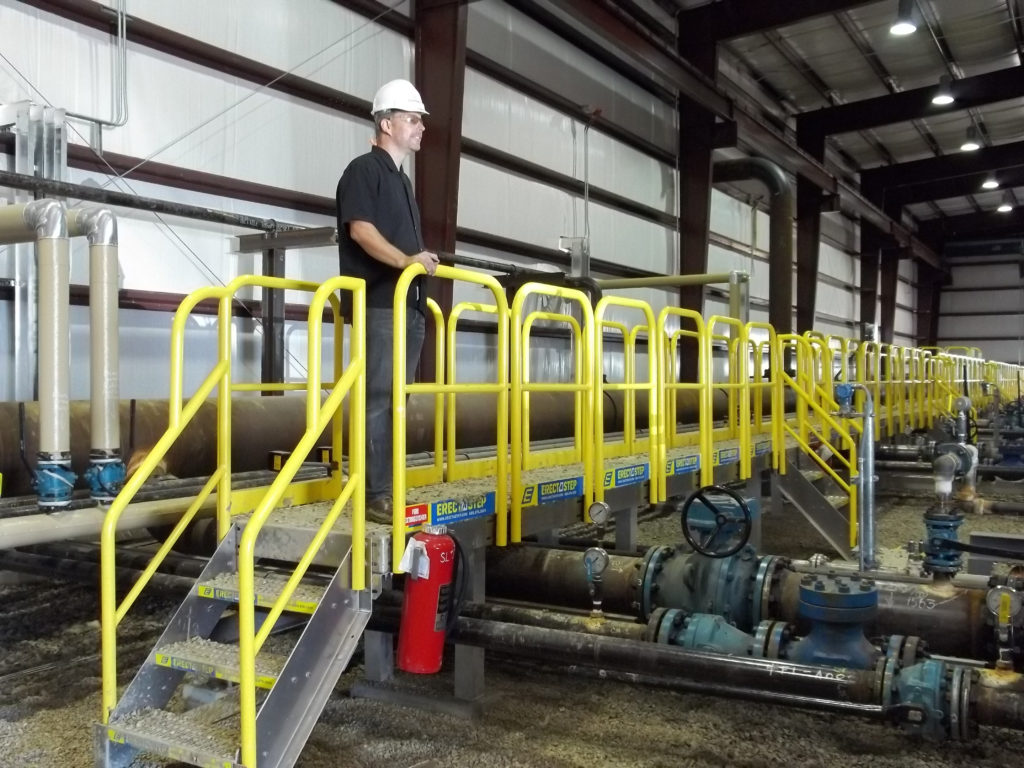 Erectastep pipe crossover stairs in manufacturing plant